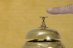 Desk bell. Against a yellow wall royalty free stock photos