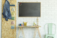 Desk, blackboard, chair and osb board Stock Photography