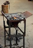 Desk blacksmith with coals Royalty Free Stock Photos