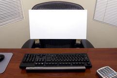 Desk and Blank Sign Royalty Free Stock Images