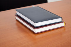 Desk with books and documents Stock Photography