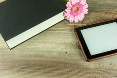 Desk with books, ebook reader Royalty Free Stock Photo