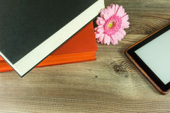 Desk with books, ebook reader Stock Images