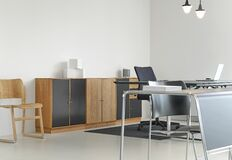 Desk and cabinets in office Stock Image