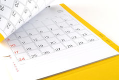 close up cardboard desk calendar with days and dates of April 2016 in grid and blank lines for text notes stock image