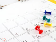 Desk calendar with days and dates in July 2016 and colorful thumbtack Royalty Free Stock Image