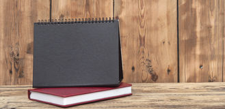 Desk calendar with red leather note book Stock Photography