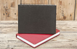Desk calendar with red leather note book Royalty Free Stock Photos