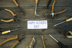 Desk of a carpenter with Happy fathers day sign Stock Images