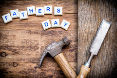 Desk of a carpenter with Happy fathers day sign. Royalty Free Stock Photos