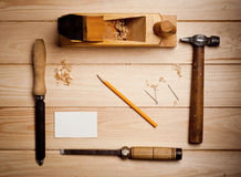 Desk of a carpenter with some tools Stock Photos