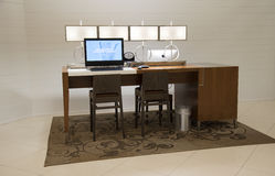 Desk chair and desktop computer for hotel guests use Stock Photo