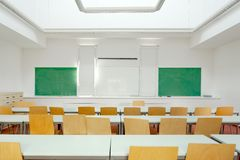 Desk and chairs in a classroom Stock Photography