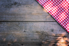 Desk and checked dishtowel. Old desk and checked dishtowel Stock Photography