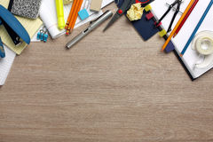 Desk cluttered with office supplies Stock Photos