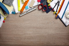 Desk cluttered with office supplies Stock Images