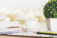 Desk with coffee and plant Stock Images
