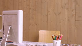 Desk with computer and colour pencils stock footage