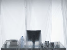 Desk And Computer Covered In Transparent Dust Sheets Royalty Free Stock Photo