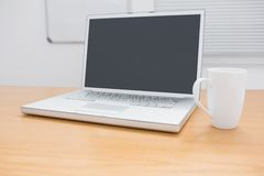 A desk with a computer Stock Photo