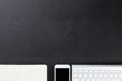Desk with computer, supplies and smartphone Stock Image