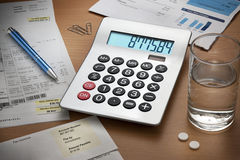 Desk Debts Bills Calculator Royalty Free Stock Photography