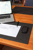 Desk with documents, laptop and smartphone Stock Images