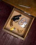 Desk Drawer Full of Self Defense Items and Gun Royalty Free Stock Images