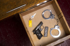 Desk Drawer of a Law Enforcement Officer Royalty Free Stock Photography