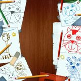 Desk with drawings of children Royalty Free Stock Photos