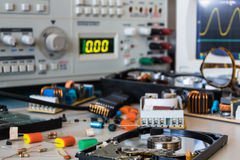 Desk in electronic laboratories, faulty HDD and power supplies b Royalty Free Stock Images