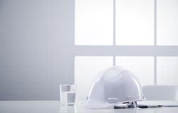 Desk engineer with hardhat Royalty Free Stock Image