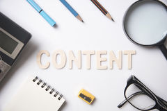 Desk with equipment and wording Content concept. Can used for cover page presentation and web banner Royalty Free Stock Photo
