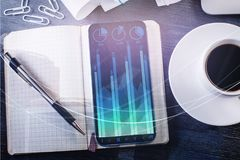 Desk with forex chart on smartphone Stock Images