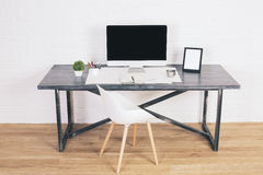 Desk with frames and monitor Stock Photo