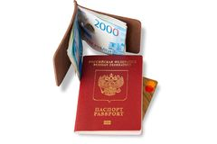 Desk of frequent traveler - angle view. The composition of essential items for trip: passport with multiple entry stamps, foreign royalty free stock photos