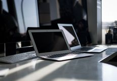 A desk full of Apple computer products Royalty Free Stock Images