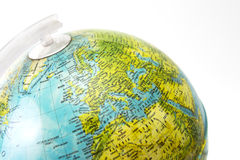 Desk globe focusing on Europe. Close-up of desktop globe focusing on Europe. Place names in Italian Stock Photos
