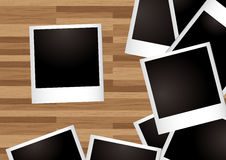 Desk instant photo. Pile of instant photographs spread on a wooden desk Stock Photography