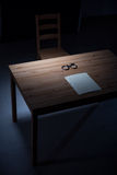 Desk in interrogation room. Image of empty desk with handcuffs in interrogation room royalty free stock photography