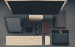Desk with keyboard, computer display and iPad Royalty Free Stock Photos