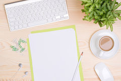 Desk with keyboard, notepaper and a cup of coffee Stock Photography