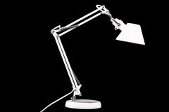 Desk Lamp. White desk lamp with chromed details on a black background Royalty Free Stock Photos