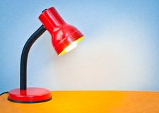 Desk lamp. Lovely colorful image of a desk lamp shining onto a surface Stock Photos