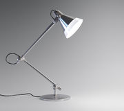 Desk lamp. 3D image of metal desk lamp  on dark background Stock Photography