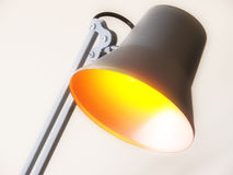 Desk lamp. A metallic desk lamp with yellow light Royalty Free Stock Photography