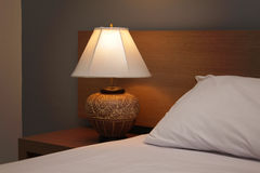 Desk Lamp with Bed Royalty Free Stock Images