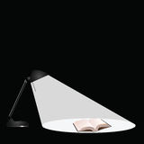 Desk lamp book. Desk lamp illuminating a book isolated with copy space Stock Images