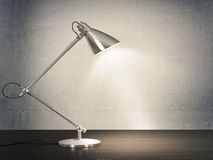 Desk lamp. 3D image of metal desk lamp on wooden desk next to the concrete wall Stock Photos