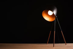 Desk lamp on empty wooden office table. As space for text or product placement Stock Photo